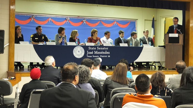 State Sen. José Menéndez (right) speaks to the crowd. On stage from left: State Rep. Ina Minjarez; SAPD Sgt. Jessie Salamé; Shelley Potter, president of San Antonio Alliance of Teachers and Support Personnel; Dr. Kimberly Ridgley, director of Guidance & Counseling at Northside ISD; Dr. Sylvia Reyna, State PTA Board of Directors; state Sen. José Menéndez; Cliff Molak, brother of David Molak; Matt Molak, father of David Molak; and Chris Molak, brother of David Molak. Photo by Abbey Francis.