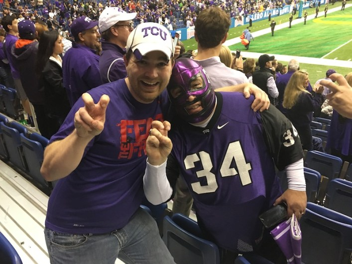"""Author Drew Irwin (left) poses for a photo with """"El Hornito"""" during the Alamo Bowl. Courtesy photo."""