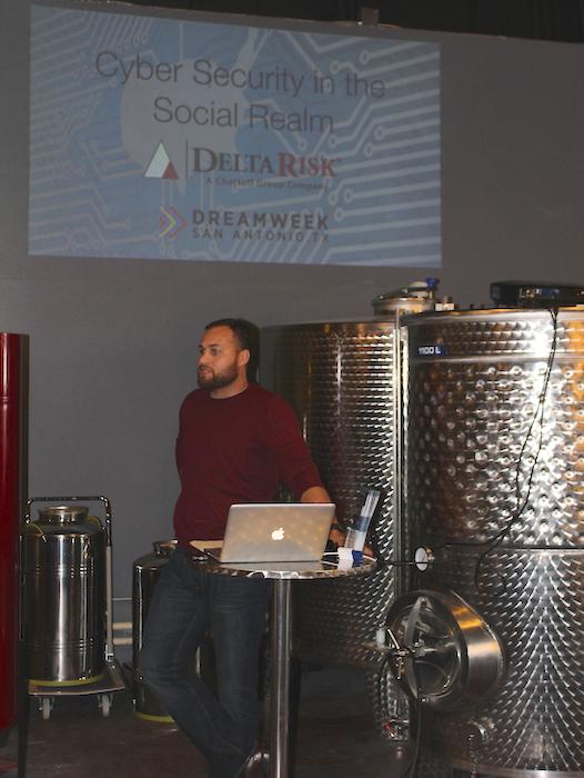 Moderator Brian Dillard stands amid the distillery equipment at Dor?ol Distillery. Photo by Iris Gonzalez.