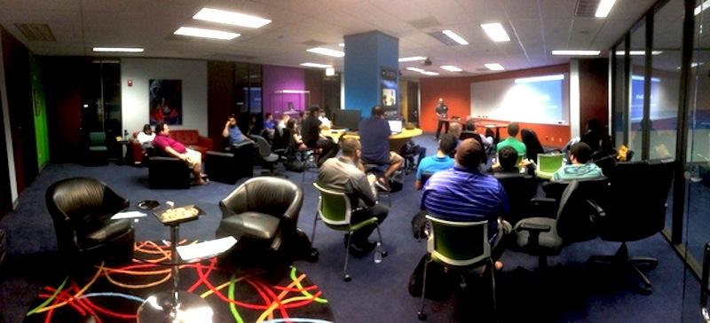 Participants listen to a presenter during the November 2015 Meetup. Photo courtesy of CyberDEF Dojo Meetup.