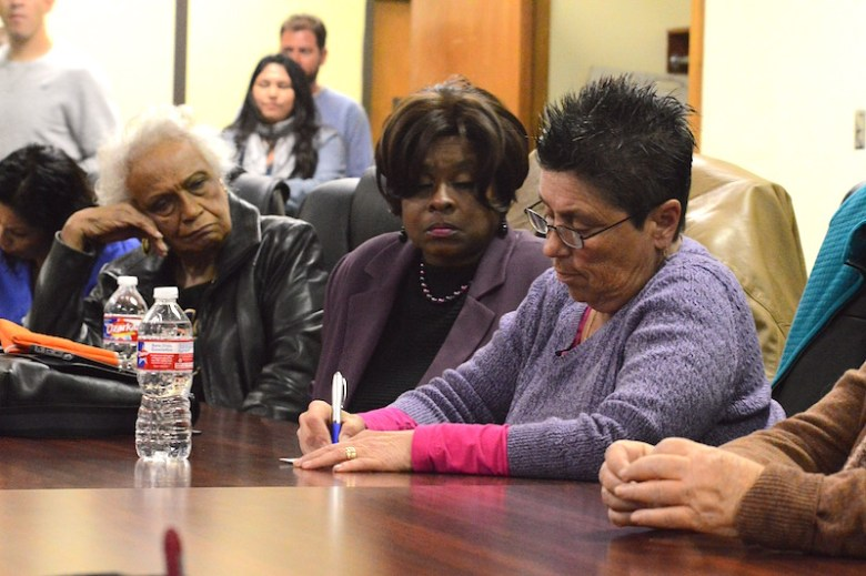 L to R: Betty Green, Dee Smith and Liz Franklin sign up for community-policing meeting updates. Photo by Lea Thompson.