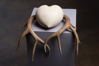 Uprooted, handcarved limestone mixed media. By Sabine Senft. Photo Courtesy of Artist.