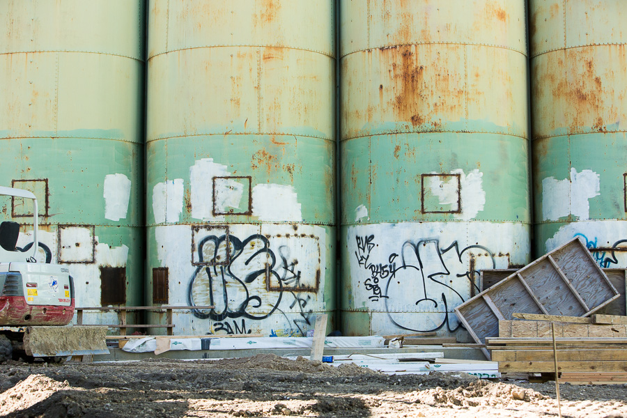 Graffiti covers the base of large Big Tex Grain Co. silos. Photo by Scott Ball.