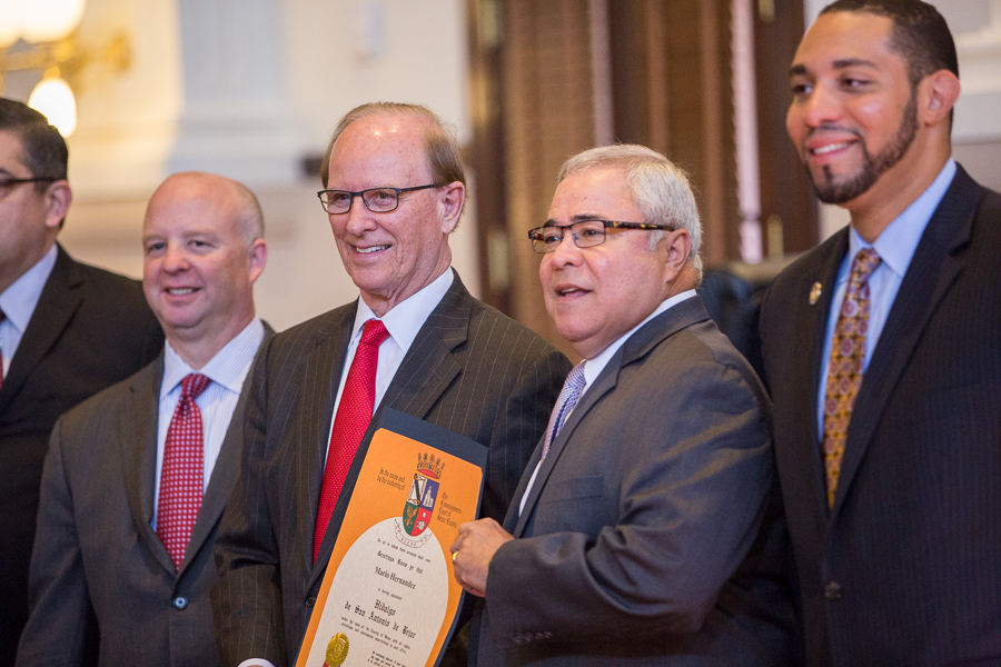 Mario Hernandez poses for a photo with Bexar County Commissioner's after receiving an Hidalgo award. Photo by Scott Ball.
