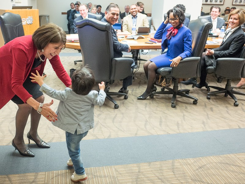 Outgoing CPS Energy Board Chair Nora Chavez receives a hug from her two-year-old grandson Noah. Photo by Scott Ball.