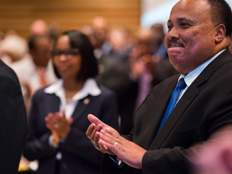 Martin Luther King III applauds after the National Anthem was sung. Photo by Scott Ball.