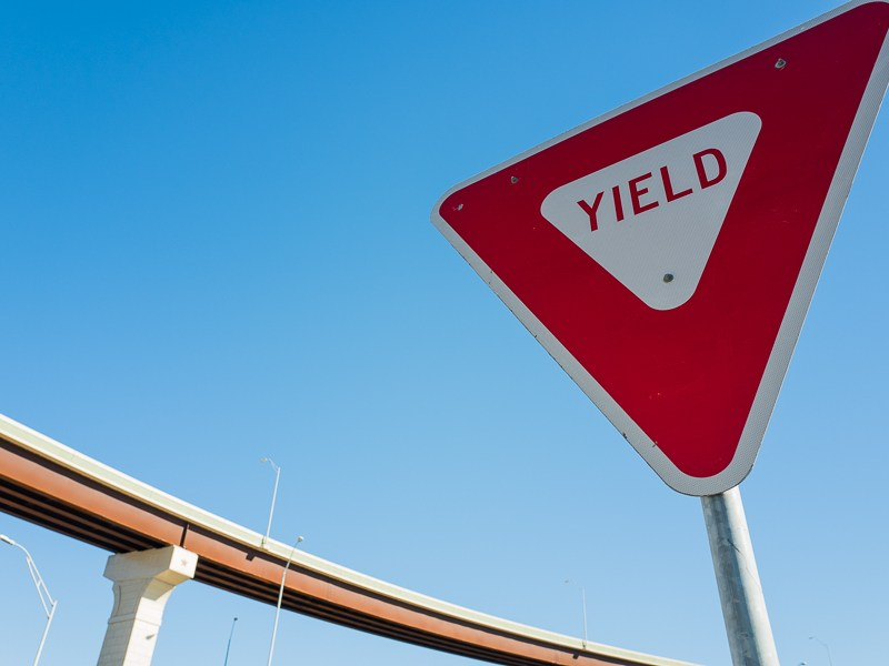 A yield sign is posted near the High 281 to Loop 1604 interchange. Photo by Scott Ball.