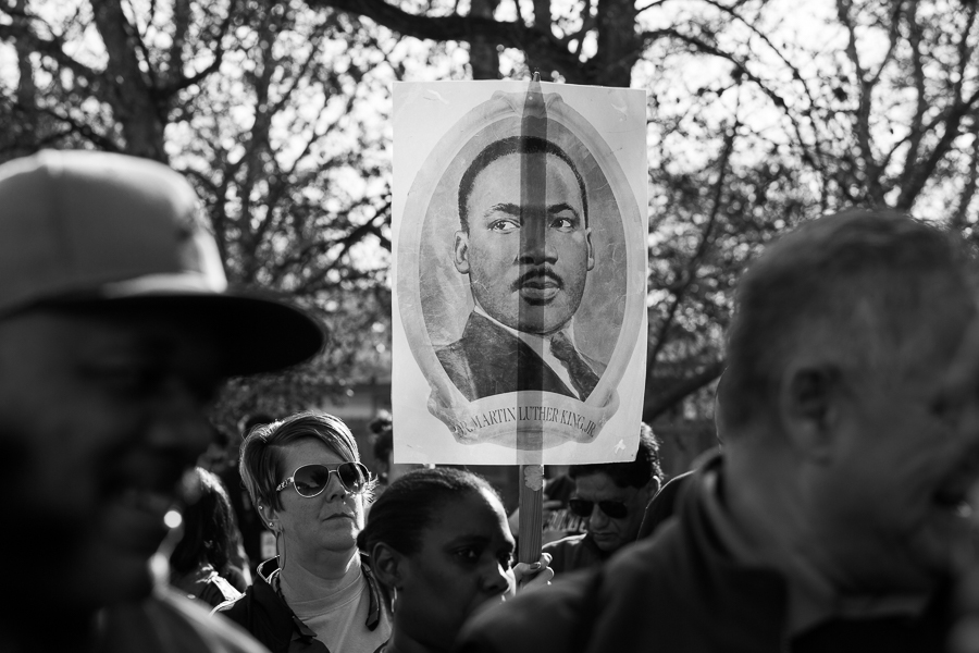 A sign that displays Martin Luther King Jr's portrait is carried during the march. Photo by Scott Ball.