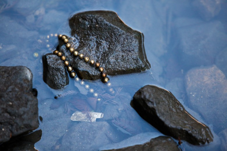 Beads were one of the many reoccuring objects found along the San Antonio River. Photo by Scott Ball.
