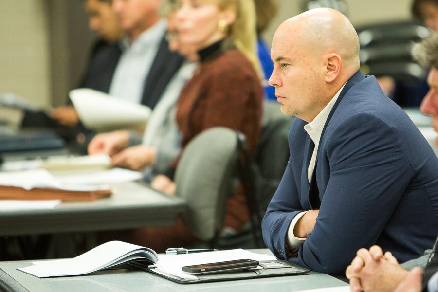San Antonio Zoo Executive Director Tim Morrow listens in during a SAISD board meeting. Photo by Scott Ball.
