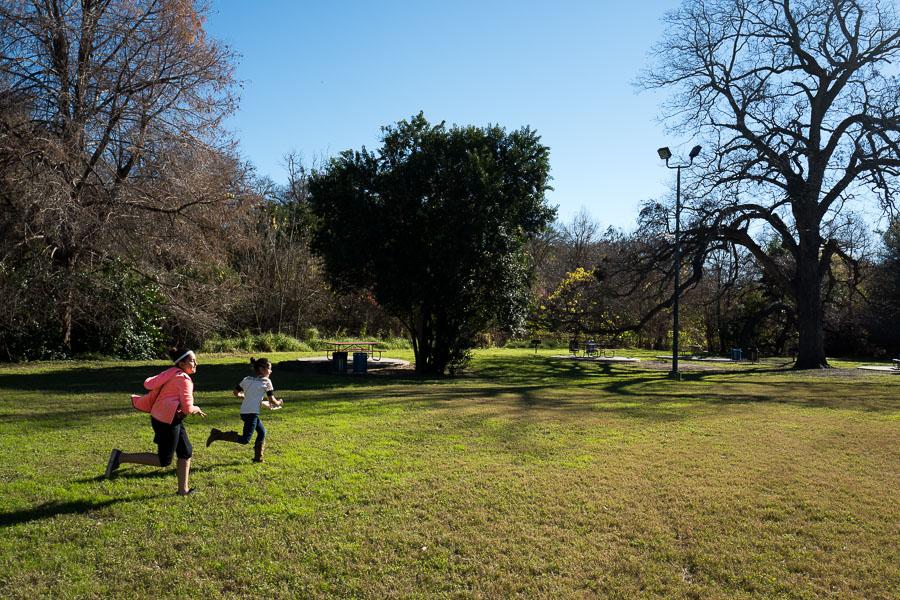 Children run through a portion of Brackenridge Park. Photo by Scott Ball.
