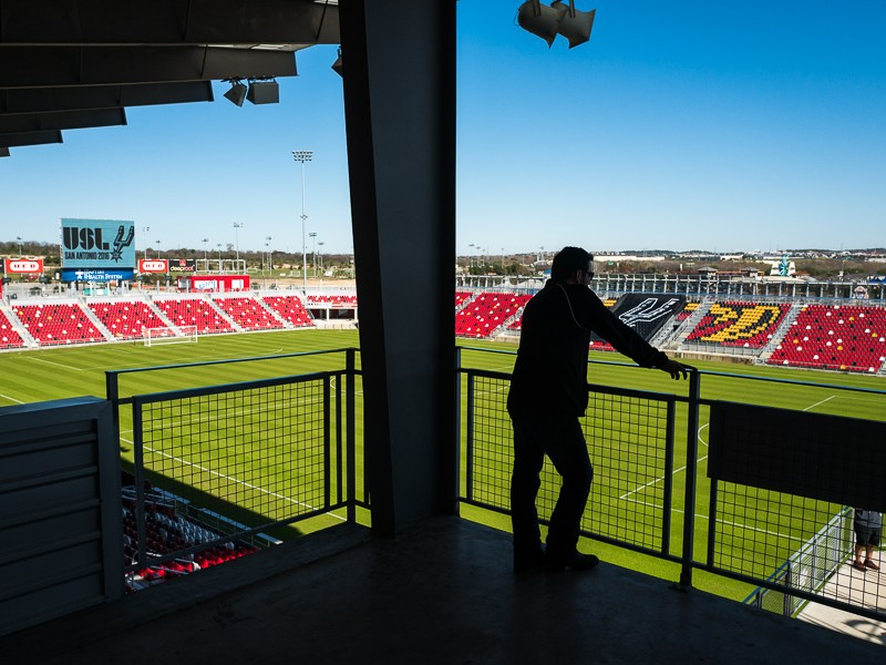 A member of the press conference overlooks Toyota Field. Photo by Scott Ball.
