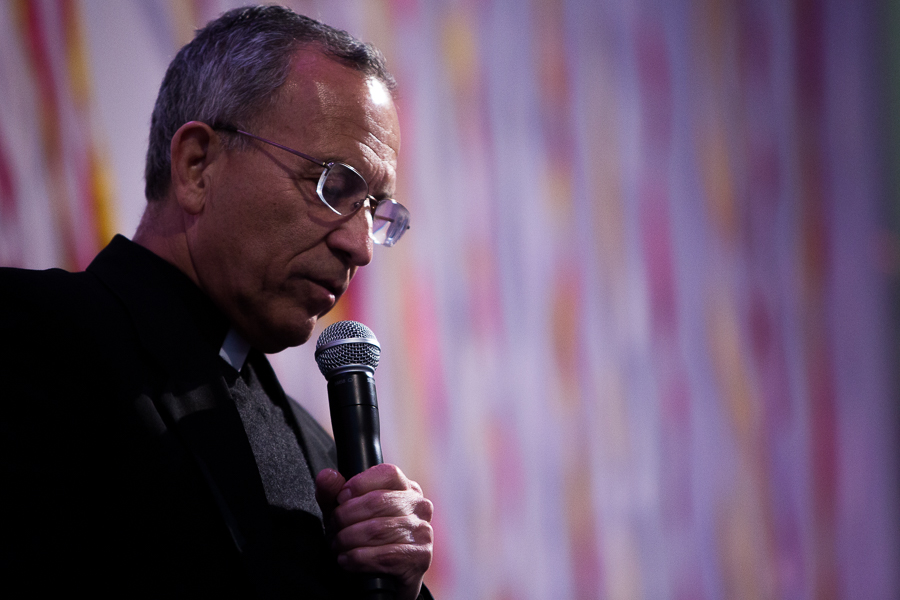 Father David Garcia gives a prayer before the event. Photo by Scott Ball.
