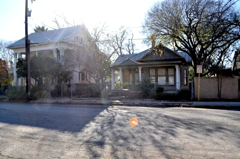 Two historic homes on Cedar Street, right next to the Children's Shelter, are not part of the townhome project. Photo by Iris Dimmick.