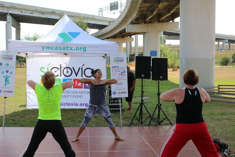 A YMCA Group Exercise instructor leads a yoga class at Síclovía on Sept. 27, 2015. Photo courtesy of YMCA of Greater San Antonio.