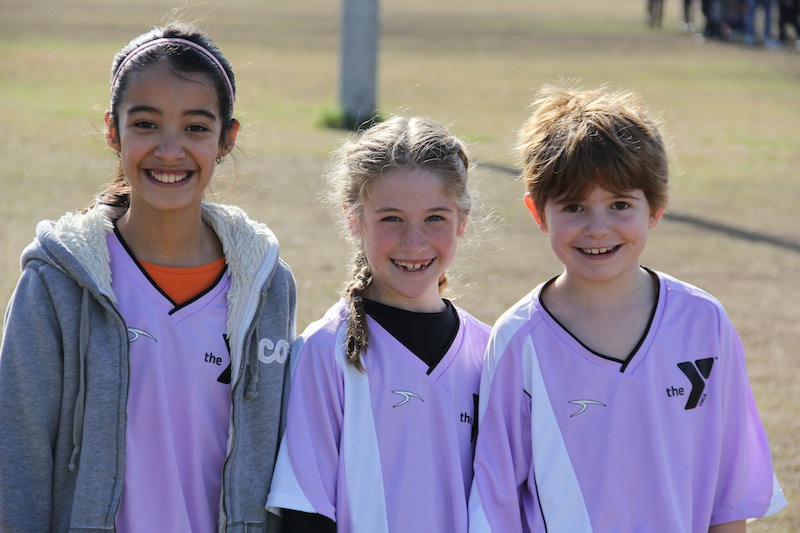 A group of young girls get ready for their soccer game at the YMCA at O.P. Schnabel Park. Photo courtesy of YMCA of Greater San Antonio.