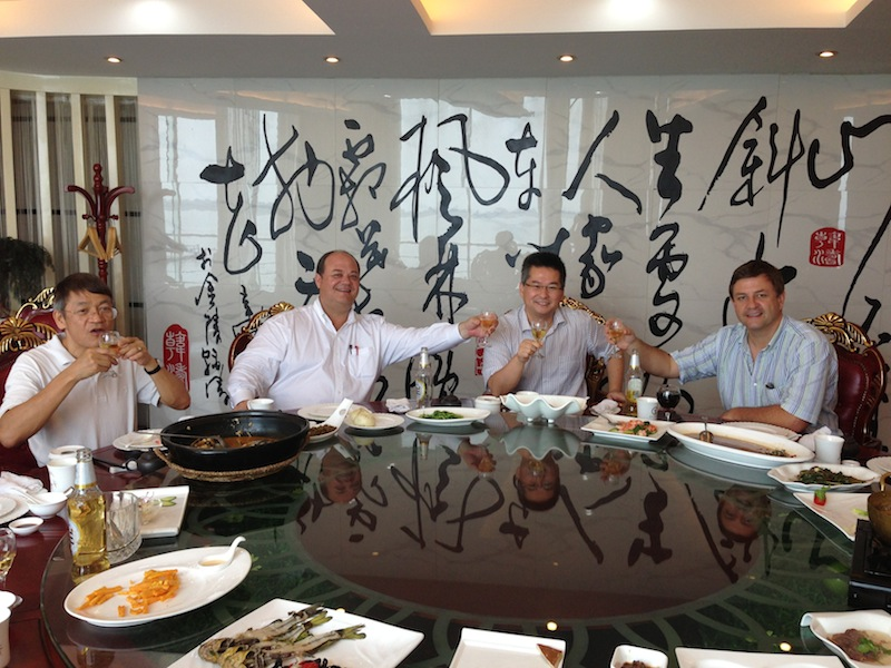 San Antonio architects celebrate the approval of their master plan with their Chinese clients in Gaochun, China. Photo courtesy of Overland Partners.