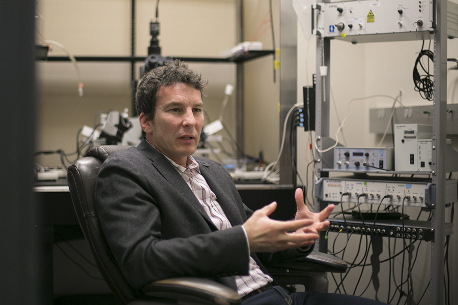 UTSA neuroscience researcher Carlos Paladini explains how his research into manipulating dopamine levels could impact people with clinical depression, drug addiction, schizophrenia, PTSD or Parkinson's. Photo by Kathryn Boyd-Batstone
