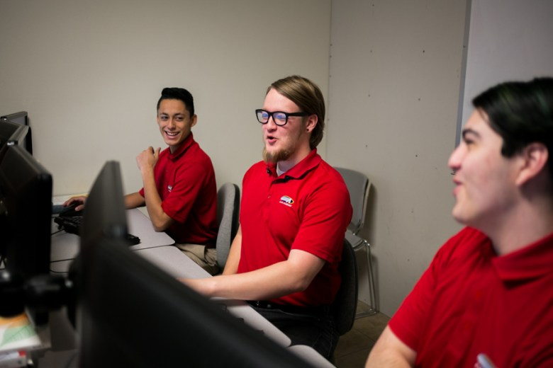 From left to right, Hector Iruegas, Reed Shaukat, and Kyle Volz are on the senior Information Technology & Security Academy team competing in CyberPatriot. Photo by Kathryn Boyd-Batstone