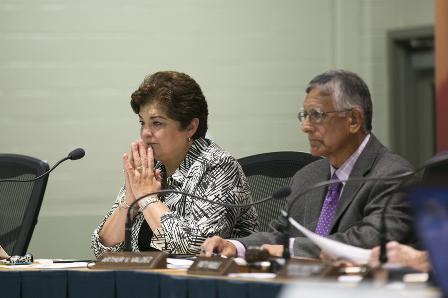 San Antonio Independent School District Trustee Olga Hernandez gets teary eyed while listening to COPS/Metro leaders and SAISD employees call for an increase in wages for the lowest-paid workers in the district. Photo by Kathryn Boyd-Batstone
