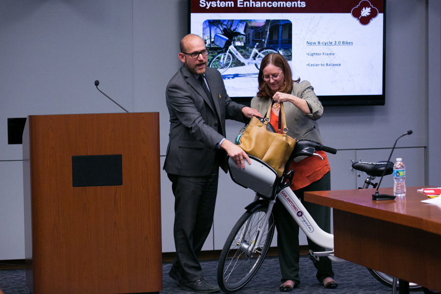 Douglas R. Melnick, Chief Sustainability Officer, and J. D. Simpson, executive director of San Antonio Bike Share, demonstrate new features on the lighter and easier to balance B-cycle. Photo by Kathryn Boyd-Batstone