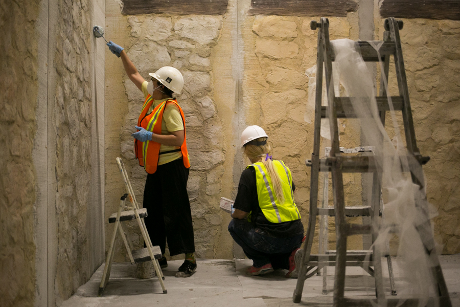 """SRO Associates Inc workers, who include artists and set designs, build the walls of the new exhibit entitled """"Battle for Texas: The Experience. Photo by Kathryn Boyd-Batstone"""