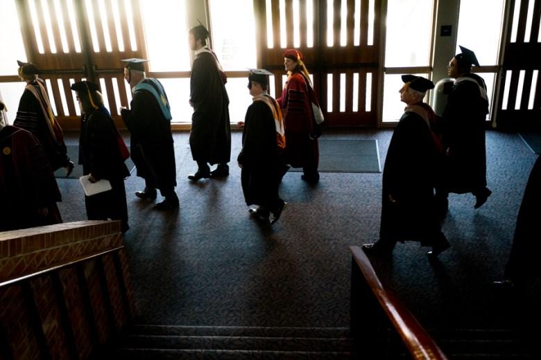 Trinity University Marshals and Alumni walk to start of the processional. Photo by Kathryn Boyd-Batstone