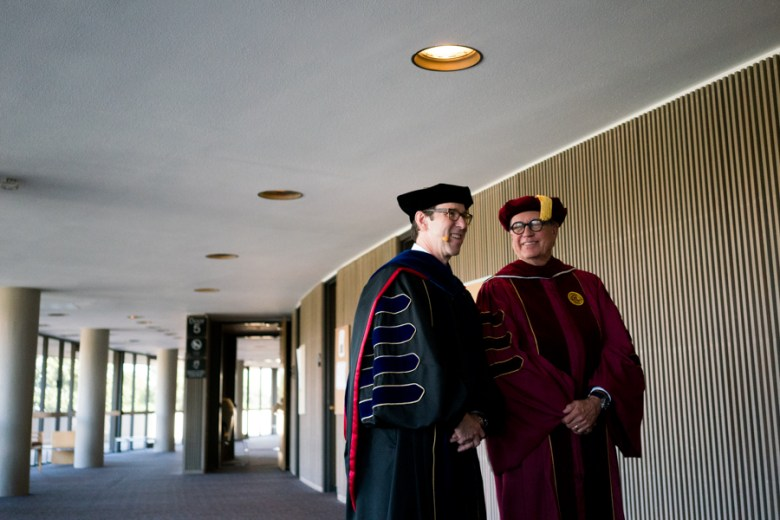 Danny Anderson speaks with Donald Clark, Murchison Professor of History, before the inauguration ceremony. Photo by Kathryn Boyd-Batstone