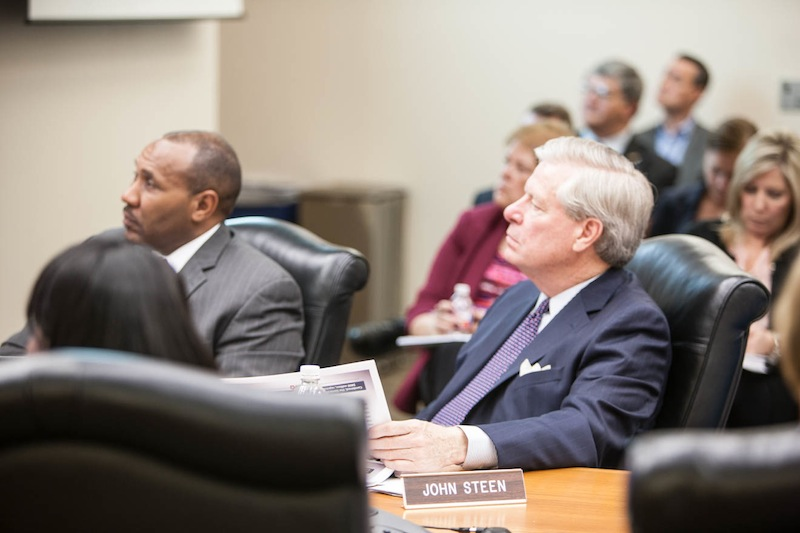 CPS Energy board members Derrick Howard (left) and John Steen listen to a program update from staff. Photo by Vincent McDonald for CPS Energy.
