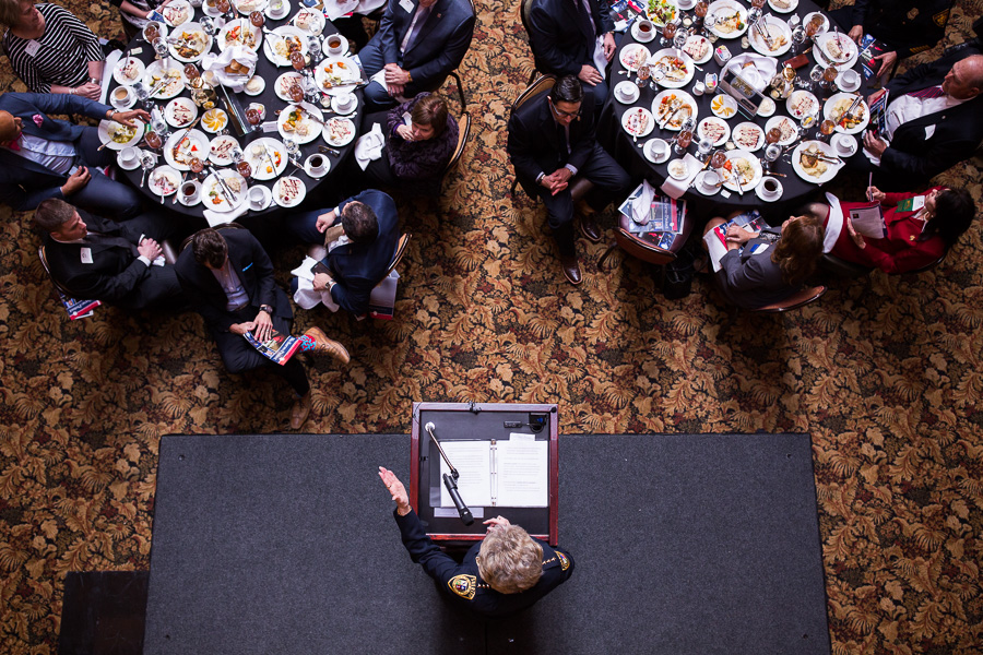 """Sheriff Susan Pamerleau directs the audience to tables filled with Bexar County Officers, """"Don't you feel safe?"""" she said. Photo by Scott Ball."""
