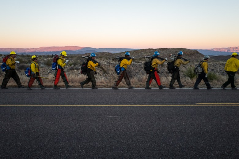 The Indian Affairs Zuni IHC Hotshots walk in unison as they arrive to their vehicle for transportation after a full days work. Photo by Scott Ball.