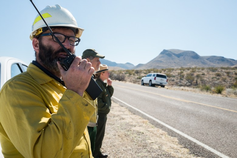 (left to right) Firefighter Brent Woffinden, Public Information Officer David Elkowitz, and Park Ranger Jennette Jurado stand and observe the fire along side Gano Springs Road in the black zone. Photo by Scott Ball.