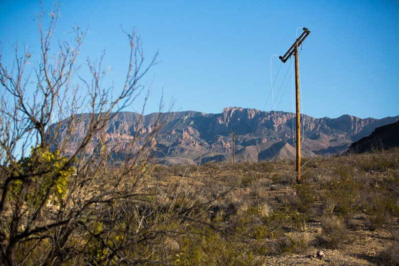 An unaffected power line stands tall but broken with snapped wires in Big Bend National Park. Photo by Scott Ball.