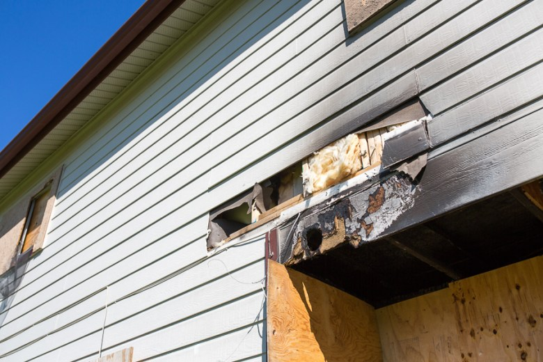 Probable fire damage was visible on one of the homes set to be demolished. Photo by Scott Ball.