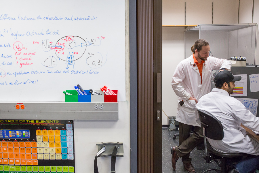 Zack Jordan and Justin Avila work in one of the specialized rooms in the Gdovin biology laboratory. Photo by Scott Ball.