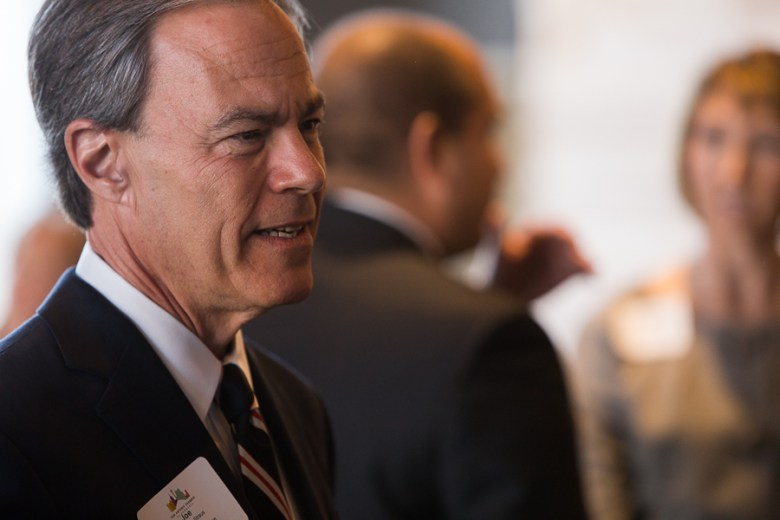 Texas House Speaker Joe Straus speaks with public officials and San Antonio Chamber of Commerce invitees in a private VIP room before his speaking engagement. Photo by Scott Ball.