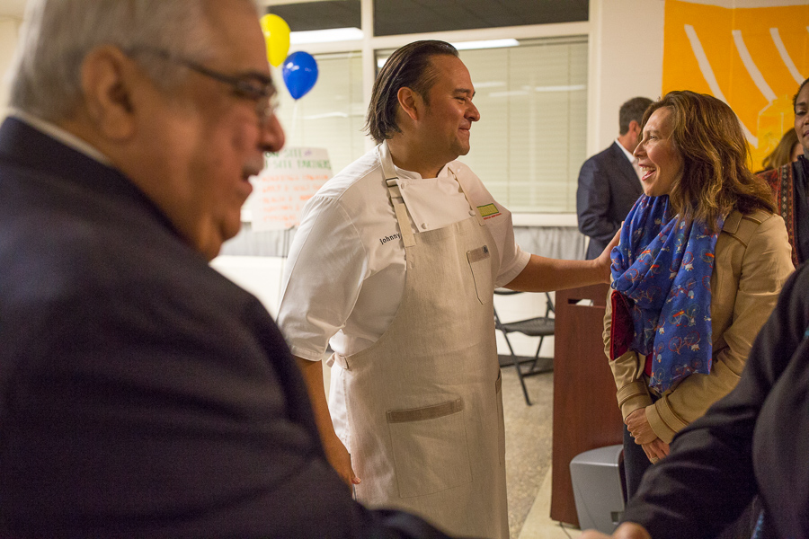 Chef Johnny Hernandez embraces Councilwoman Shirley Gonzales (D5) following the announcement of a 1.5 million dollar contribution from Bexar County announced by Commissioner Paul Elizondo (left) (Precinct 2). Photo by Scott Ball.