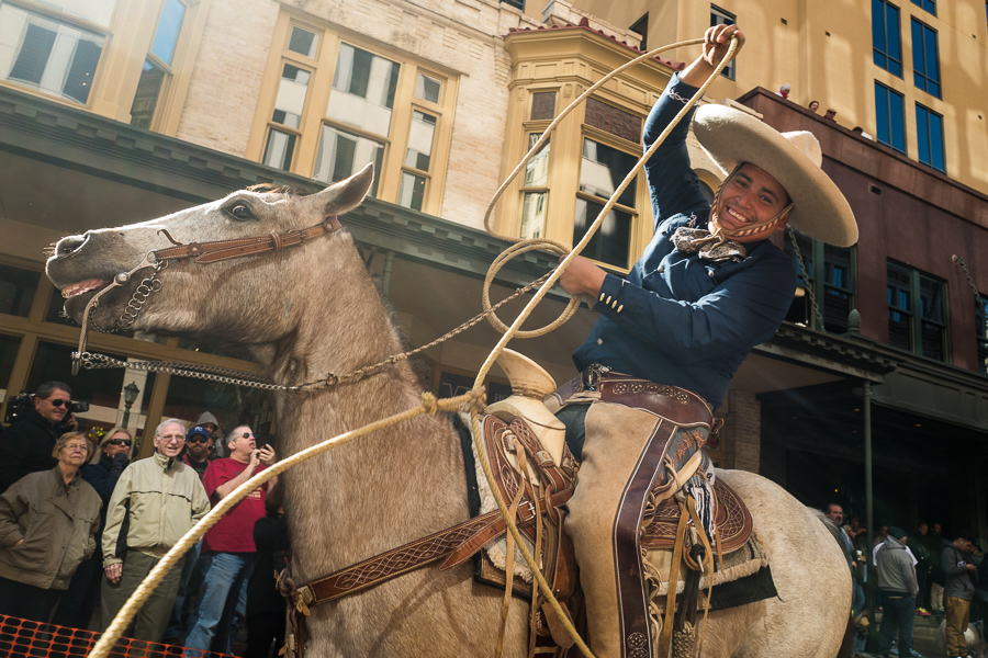 A charro swings his rope as his faithful horse reacts. Photo by Scott Ball.