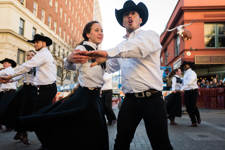Texas A&M Aggie Wranglers dance in front of The Buckhorn Saloon on Houston Street. Photo by Scott Ball.
