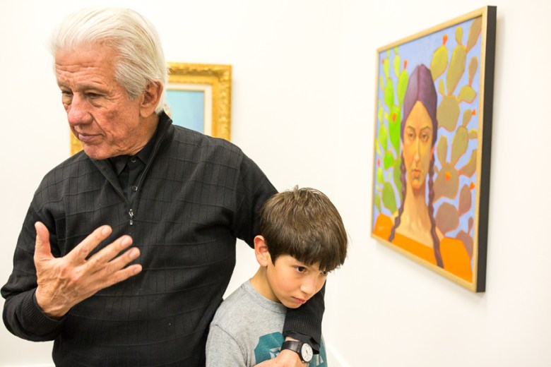 Lionel Sosa speaks as he embraces his grandson Giovani, 10. Photo by Scott Ball.