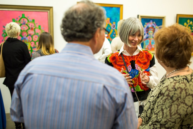 Kathy Sosa speaks with guests that have come to see her work. Photo by Scott Ball.