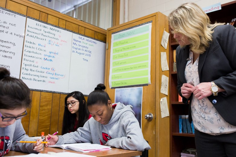 When on campus, Lisa Riggs spends most of her time in the classroom monitoring both students like (left to right) Caroline Alvarado and Alizon Crisanto and teachers. Photo by Scott Ball.