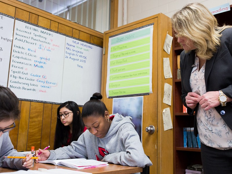 When on campus, Lisa Riggs spends most of her time in the classroom monitoring both teachers and students like Caroline Alvarado (left) and Alizon Crisanto.