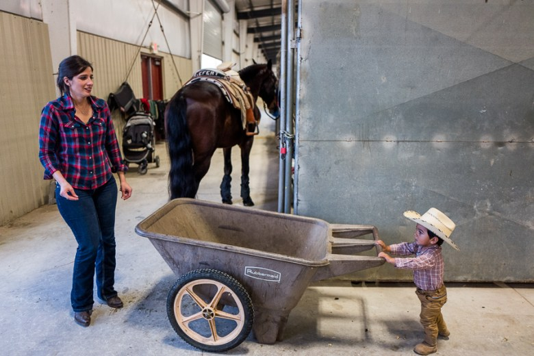 Louis, 17 months, pushes a hauling cart as his mother Justine Garcilazo arrives. Photo by Scott Ball.