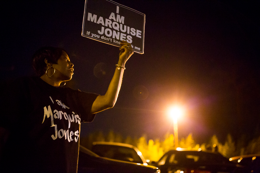 "Protestor Ivory Rice holds up a sign that reads ""I Am Marquise Jones"". Photo by Scott Ball."