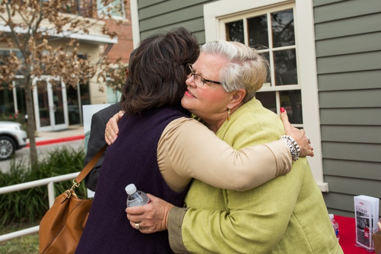 Architect and professor Sue Ann Pemberton hugs a guest following the event. Photo by Scott Ball.