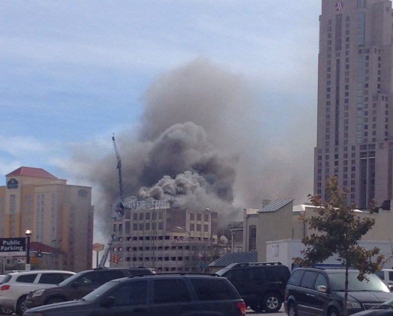 Smoke billows from the parking garage on Monday afternoon. Photo by Seema Kairam.