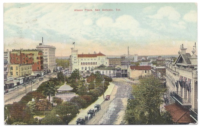 A postcard, postmarked 1911, looking north across Alamo Plaza. Pictured left to right: Crockett Block, Maverick Bank, Gibbs Building, U.S. Courthouse and Post Office, the Alamo, and Menger Hotel. A bandstand occupies the center of the landscaped park. Photo courtesy of the San Antonio Conservation Society Foundation