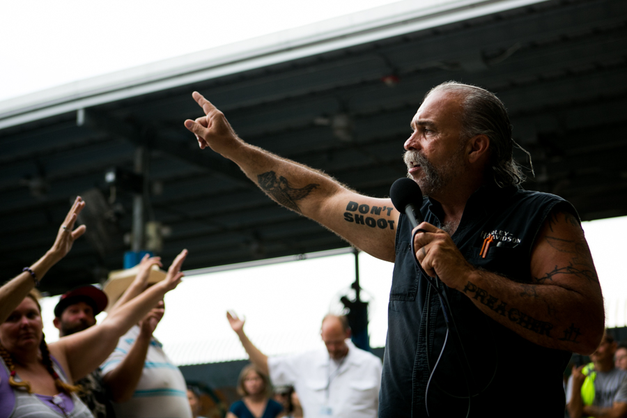 Machine Gun Preacher Sam Childers asks Haven For Hope residents to raise their hands if they want to be successful. Photo by Kathryn Boyd-Batstone