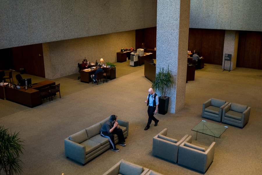 Frost Bank customers wait to be helped in the lobby of the downtown building. Photo by Kathryn Boyd-Batsotne